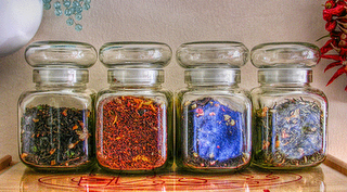 jars of colored tea leaves